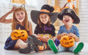 kids laughing dressed for Halloween