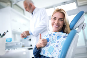 Woman at dentist in Pasadena giving thumbs up