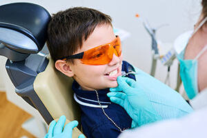 Young boy receives dental sealants