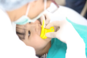 Young child receives fluoride treatment