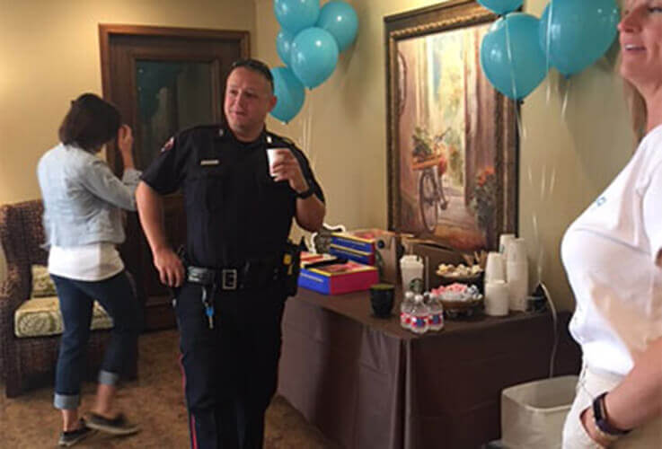 Officer drinking coffee at breakfast
