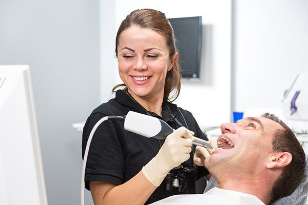 Dental patient views the intraoral camera