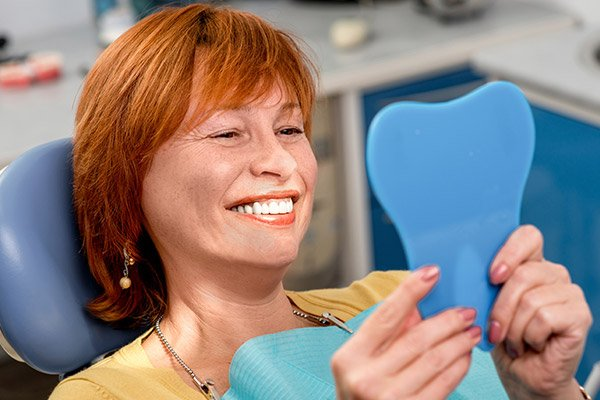 Smiling patient in dental chair