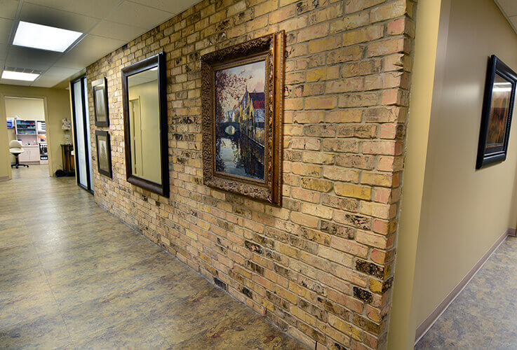 Rustic brick wall in hallway