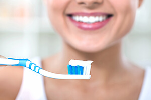 Patient smiling holding toothbrush