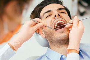 Male patient relaxed during root canal therapy
