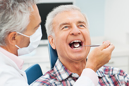 Older male patient during dental checkup