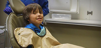 Young patient in dental chair