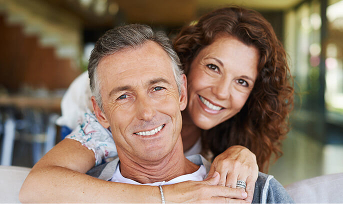 Older man and woman smiling happily