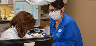 Dentist and assistant provide periodontal therapy