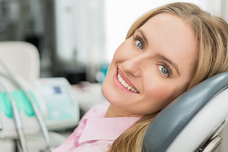 Female patient in dental chair smiling