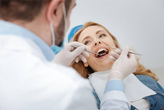 Dentist placing a tooth-colored filling